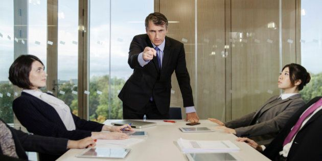 Businessman pointing finger in meeting at office conference room