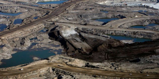 The Syncrude Canada Ltd. oil sands mine stands in this aerial photograph taken near Fort McMurray, Alberta,...