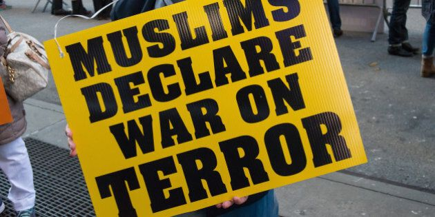 TIMES SQUARE, NEW YORK, NY, UNITED STATES - 2015/11/21: A Palestinian-American demonstrator holds a sign at the rally. About a hundred members of New York's Muslim-American community and non-Muslim supporters gathered in Times Square for the two-fold purpose of expressing grief for the victims of recent attacks by Islamic State extremists and to condemn the Islamic State's radical interpretation of Islam and the terrorist acts carried out by them. (Photo by Albin-Lohr Jones/Pacific Press/LightRocket via Getty Images)