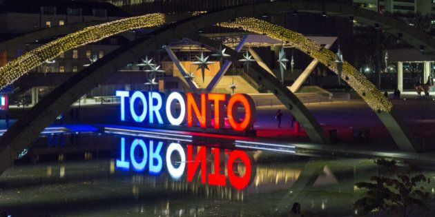 NATHAN PHILLIPS SQUARE, TORONTO, ONTARIO, CANADA - 2015/11/14: The Toronts sign is light in the colors...