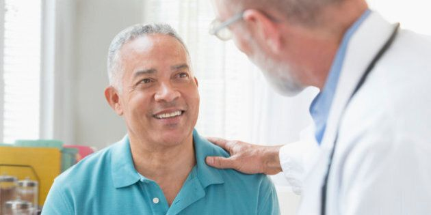 Doctor talking to patient in