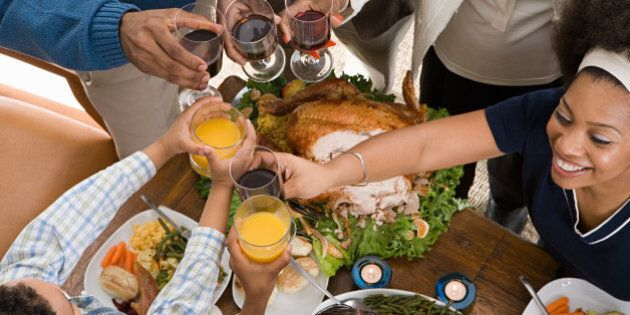 Family toasting at christmas dinner -