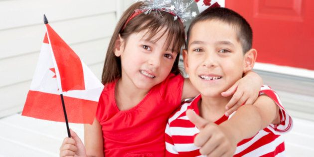 Siblings age 6 and 7 celebrating Canada Day