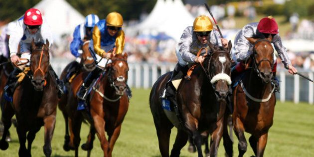 CHICHESTER, ENGLAND - JULY 31: Gregory Benoit riding Amy Eria (2R) win The L'Ormarins Queen's Plate Stakes...