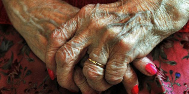 File photo dated 05/12/08 of the hands of an elderly woman. Close friends and family of patients who...