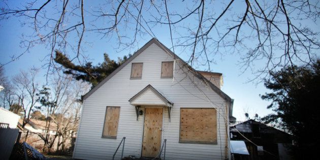 ISLIP, NY - FEBRUARY 09: A foreclosed home stands boarded up on February 9, 2012 in Islip, New York....