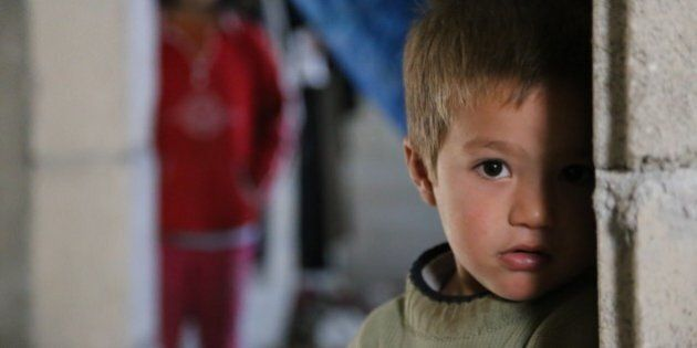 HATAY, TURKEY - NOVEMBER 21: A Syrian refugee kid fled from his home due to civil war is seen at a house...