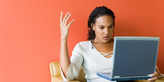Frustrated businesswoman with laptop