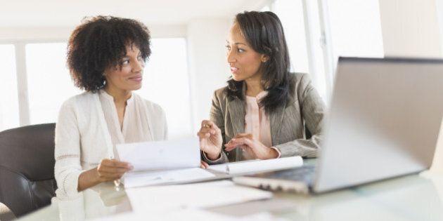 African American businesswomen talking in