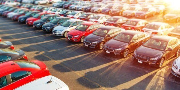 Dealer New Cars Stock. Colorful Brand New Compact Vehicles For Sale Awaiting on the Dealer Parking Lot....