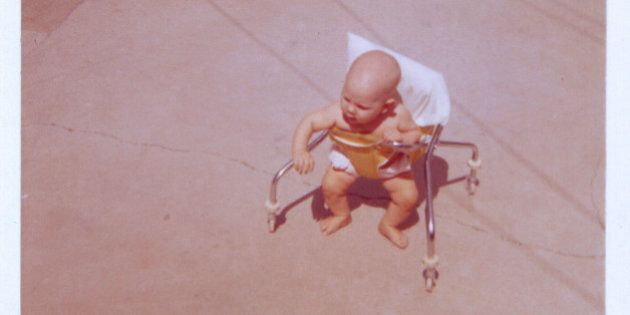 Child in baby walker, circa.