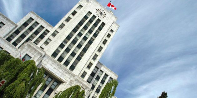 A series of photos of Vancouver BC Canada's city hall building and