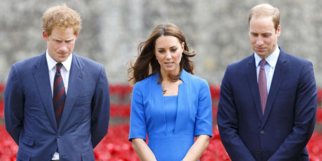 LONDON, UNITED KINGDOM - AUGUST 05: (EMBARGOED FOR PUBLICATION IN UK NEWSPAPERS UNTIL 48 HOURS AFTER CREATE DATE AND TIME) Prince Harry, Catherine, Duchess of Cambridge and Prince William, Duke of Cambridge visit the poppy field art installation entitled 'Blood Swept Lands and Seas of Red' by artist Paul Cummins, in the moat of the Tower of London, to commemorate the First World War on August 5, 2014 in London, England. By it's completion on Armistice Day 2014 the moat will contain 888,246 ceramic poppies, one for each British and Colonial fatality during World War One. (Photo by Max Mumby/Indigo/Getty Images)