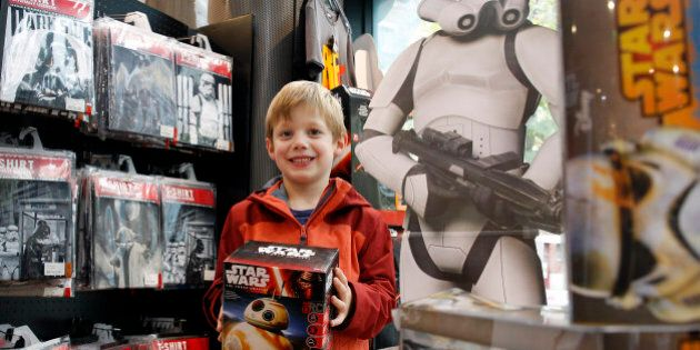 PARIS, FRANCE - NOVEMBER 04: A kid shows a box of Sphero BB-8 Star Wars droid for sale at La Grande Recre'...