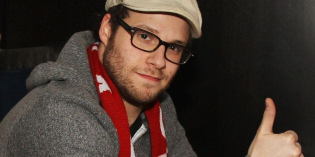 Actor Seth Rogen poses for a photo in the NHL hockey suite while watching the United States take on Canada...