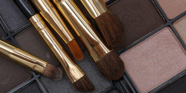 Close up of a make up kit. Brush and eye-shadows. Macro shot.