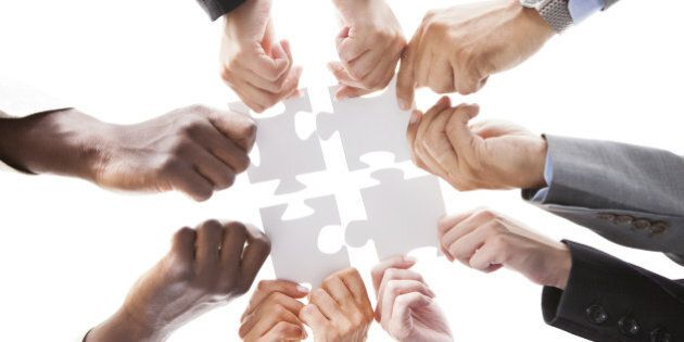 Close-up Photo Of Businesspeople Holding Jigsaw
