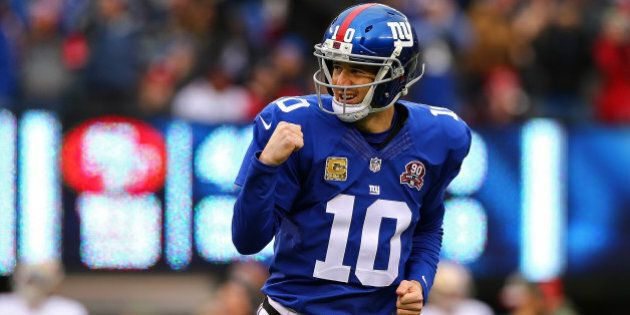 EAST RUTHERFORD, NJ - NOVEMBER 16: Eli Manning #10 of the New York Giants celebrates after throwing a...
