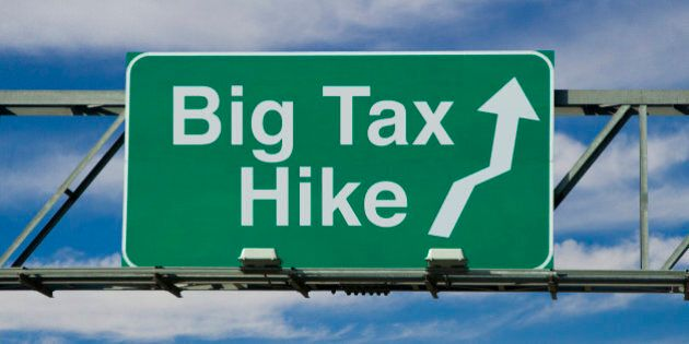 A road sign that says 'Big Tax