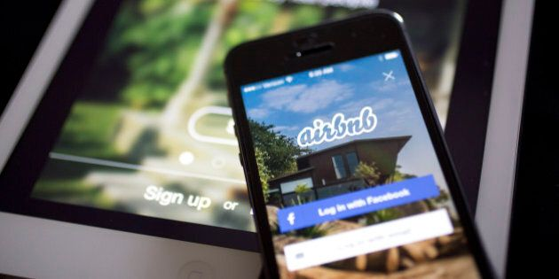 The Airbnb Inc. application is displayed on an Apple Inc. iPhone and iPad in this arranged photograph...