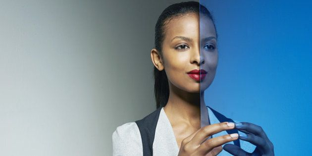 business woman with mirror