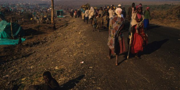 Rwandan Hutu refugees who fled the Tutsi army with little more than the clothes on their back arrive...