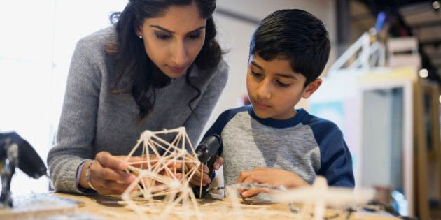 Mother and son assembling toothpick model science