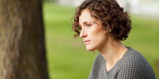 Mature woman thinking at the park