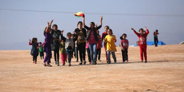 DEREK, SYRIA - NOVEMBER 13: Yazidi refugees celebrate news of the liberation of their homeland of Sinjar...