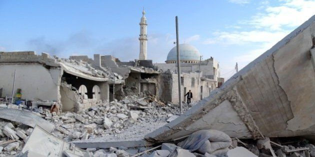 ALEPPO, SYRIA - FEBRUARY 2: Collapsed buildings are seen after Russian air crafts hit residential area at Anadan district of Aleppo, Syria on February 2, 2016. (Photo by Ahmed Muhammed Ali/Anadolu Agency/Getty Images)