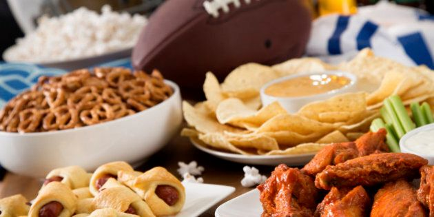 Hot wings, nachos, pigs in a blanket, beer, and popcorn, a tailgate party spread. Please see my portfolio...