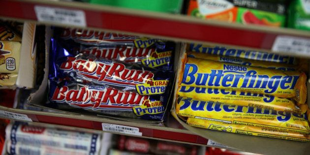 SAN FRANCISCO, CA - FEBRUARY 18: Nestle Butterfinger and Baby Ruth candy bars are displayed on a shelf...