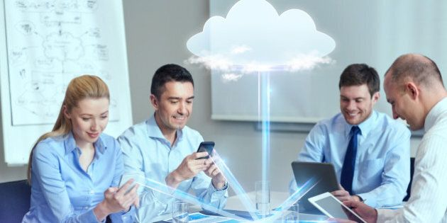 business, people, cloud computing and technology concept - smiling business team with smartphones, tablet...