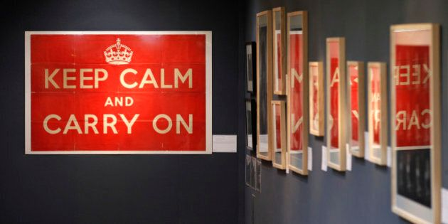 An original 1939 Ministry of Information 'Keep Calm and Carry On' poster, left, is seen on display at Christie's auction house in London, Thursday, Aug. 30, 2012. The poster is to be auctioned in  'The London Sale' on Sept. 3 as is expected to realise a price of 800 to 1,200 pounds (US$1,267 to 1,900 or euro1,010 to 1,515 euro). (AP Photo/Sang Tan)