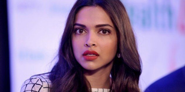 Indian Bollywood film actrss Deepika Padukone poses during the launch of the 'NDTV Fortis Health4U' nationwide Campaign in Mumbai on September 12, 2014. AFP PHOTO        (Photo credit should read STR/AFP/Getty Images)