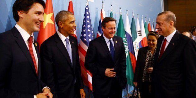 ANTALYA, TURKEY - NOVEMBER 15: Turkish President Recep Tayyip Erdogan (R), Canadian Prime Minister Justin Trudeau (L), US President Barack Obama (L-2) and British Prime Minister David Cameron (L-3) attend a working dinner on the 'Global Changes: Terrorim, Refugee Crisis' during the G20 Turkey Leaders Summit on November 15, 2015 in Antalya, Turkey. (Photo by Kayhan Ozer/Anadolu Agency/Getty Images)