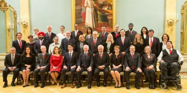 Canadian Governor General David Johnston and Prime Minister Justin Trudeau pose for a photo with Trudeau's cabinet after being sworn in at Rideau Hall in Ottawa, Ontario,, November 4, 2015.    AFP PHOTO/ GEOFF ROBINS        (Photo credit should read GEOFF ROBINS/AFP/Getty Images)