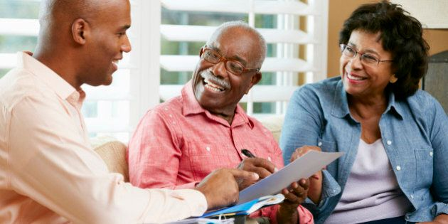 Financial Advisor Talking To Senior Couple At