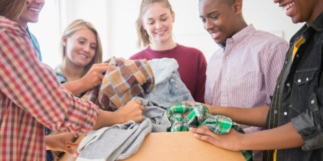 Teenagers donating clothes to charity