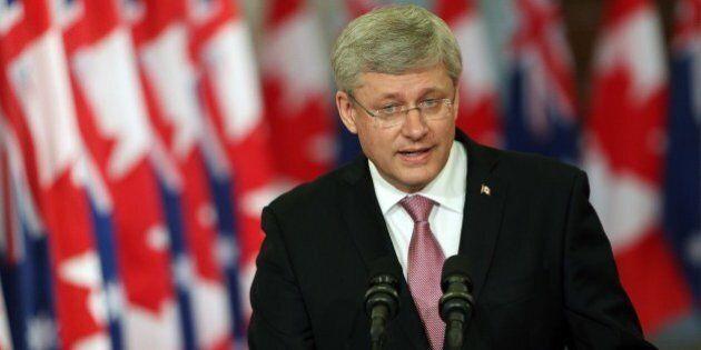 Canadian Prime Minister Stephen Harper addresses media alongside Australian Prime Minister Tony Abbott...