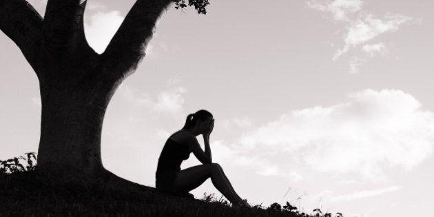 silhouette of sad woman sitting ...