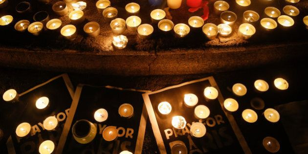 SHANGHAI, SHANGHAI - NOVEMBER 16:  (CHINA OUT) Candles are seen in a memorial tribute to the victims in French terror attack at the French Shanghai Consulate on November 16, 2015 in Shanghai, China. French suffered savage terror attach Friday night at Stade de France and a central restaurant as well as several other places which caused at least 128 dead, with 250 people wounded, 99 in critical situation, said local media.  (Photo by ChinaFotoPress/ChinaFotoPress via Getty Images)
