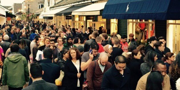 Queuing to get into Ralph Lauren. Black Friday at Bicester Village designer outlet shopping centre, Oxfordshire,...