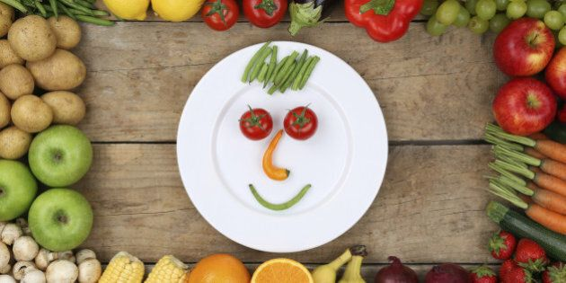 Healthy eating smiling face from vegetables and fruits on