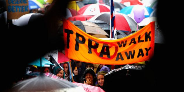 AUCKLAND, NEW ZEALAND - AUGUST 15: Anti TPPA protestors march down Queen Street on August 15, 2015 in...