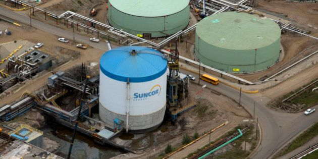 Oil storage tanks stand at a Suncor Energy Inc. oil sands mining operation near Fort McMurray, Alberta,...