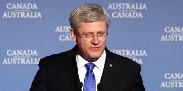 Canadian Prime Minister Stephen Harper speaks on stage at toast to Australian Prime Minister Tony Abbott during a dinner hosted by Prime Minister Harper in Ottawa, Canada on June 9, 2014.   AFP PHOTO / Cole Burston        (Photo credit should read Cole Burston/AFP/Getty Images)