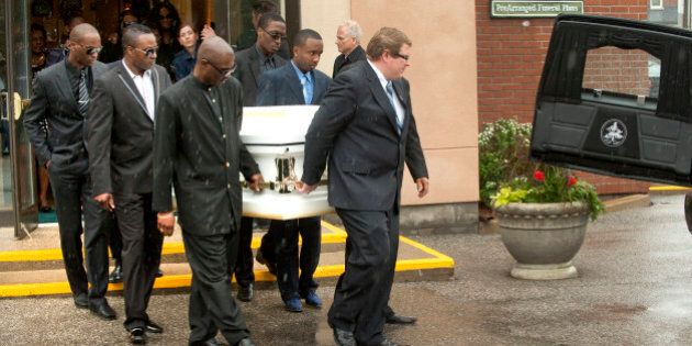 04 June 2011 memorial service for Shakeil Boothe,10, who died after a severe beating. In this pic, casket...