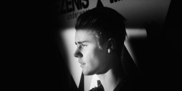 MILAN, ITALY - OCTOBER 25:  (EXCLUSIVE COVERAGE) (EDITORS NOTE: Image has been converted to black and white) An alternative view of Justin Bieber as he attends the MTV EMA's 2015 at the Mediolanum Forum on October 25, 2015 in Milan, Italy.  (Photo by Vittorio Zunino Celotto/MTV 2015/Getty Images for MTV)