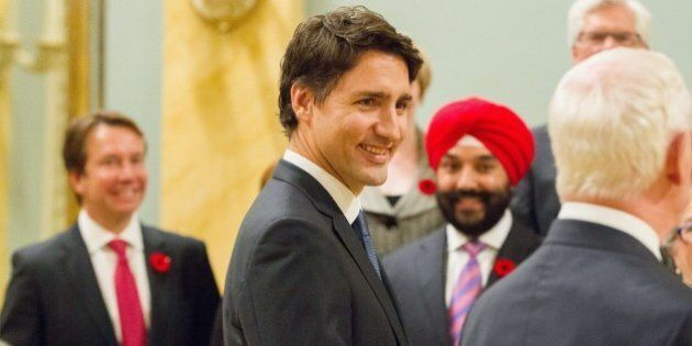 Canadian Prime Minister Justin Trudeau arrives for a photo with his newly sworn in cabinet after a ceremony...